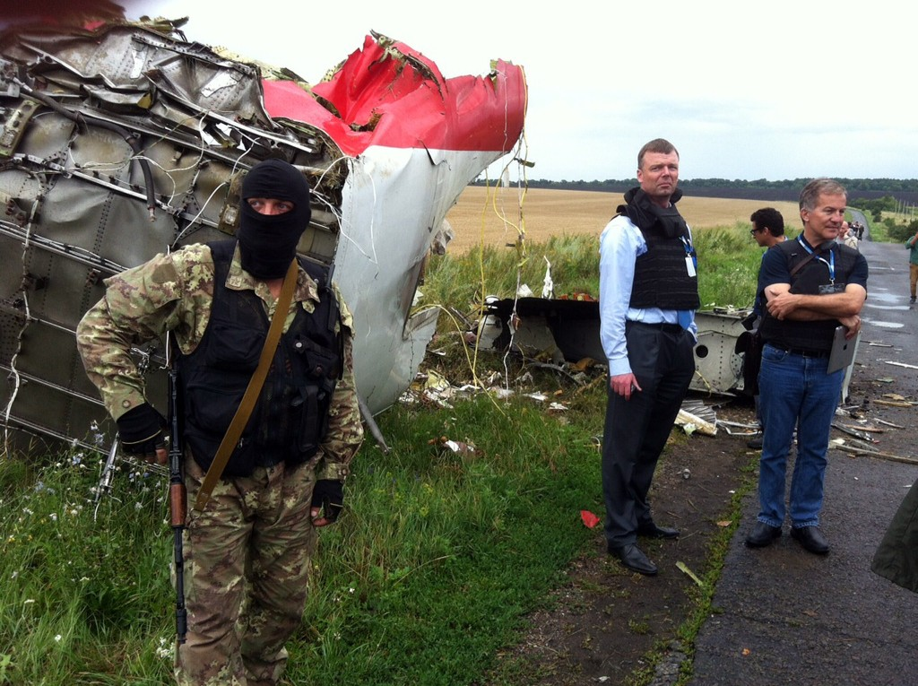 Alexander Hug, Deputy Chief Monitor of the Organization for Cooperation and Security in Europe's Special Monitoring Mission to Ukraine, visits the site of the crash of a Malaysian airliner carrying 298 people from Amsterdam to Kuala Lumpur, near the town of Shaktarsk, in rebel-held east Ukraine, on July 18, 2014. Photo by Dominique Faget/AFP