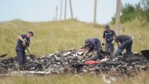 Search and rescue specialists inspect at the crash area as representatives from monitoring group of Organization for Security and Cooperation in Europe arrive to inspect at the crash area of Malaysia Airlines Boeing 777. Photo by Soner Kilinc / Anadolu Agency