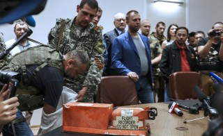 Pro-Russia separatists handed over two black boxes belonging to Malaysia Airlines flight MH17 to Malaysian representatives during a press conference in Donetsk Tuesday. British investigators will help analyze its data. Photo by STR/AFP/Getty Images