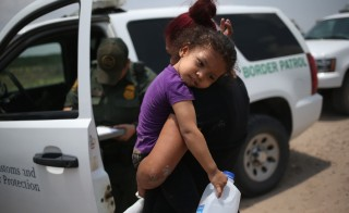 Tens of thousands of immigrants, many of them minors, have crossed illegally into the United States this year, causing a humanitarian crisis on the U.S.-Mexico border. Photo by John Moore/Getty Images