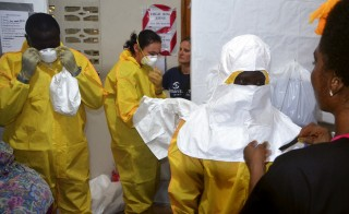 Staff of the international aid organization, Samaritan's Purse, put on protective gear at the ELWA hospital in Monrovia, Liberia. Photo by Zoom Dosso/AFP