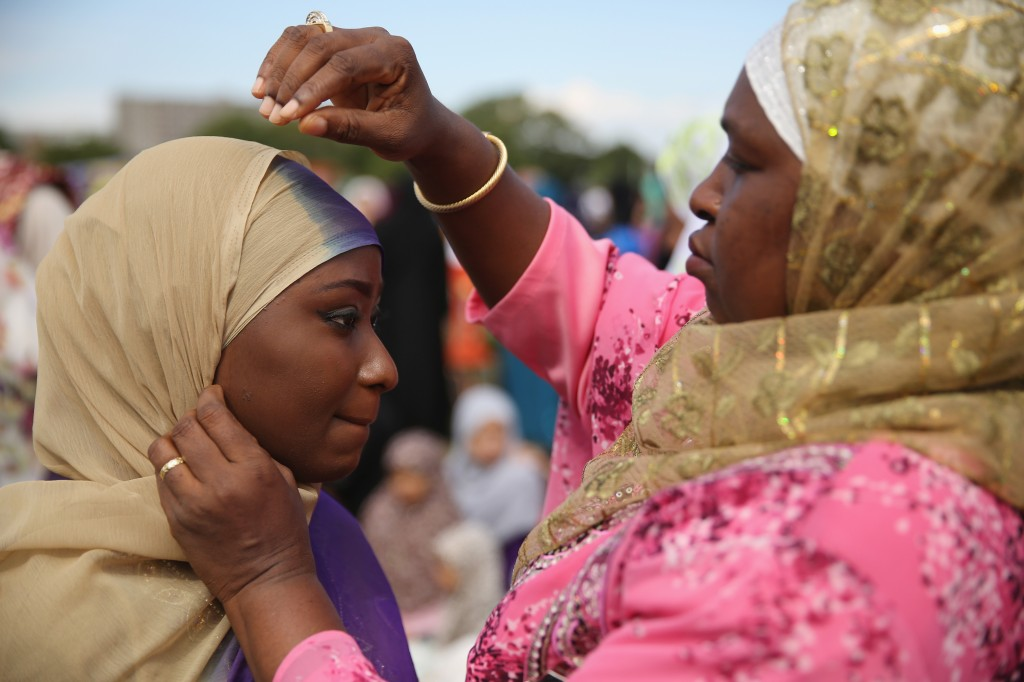 Muslim women prepare for their morning prayers ahead of an Eid celebration in Burgess Park on July 28 in London, England. Photo by Dan Kitwood/Getty Images