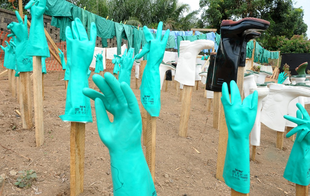 A view of gloves and boots used by medical staff, drying in the sun, at a center for victims of the Ebola virus in Guekedou, on April 1, 2014.  Photo by Seyllou/AFP/Getty Images
