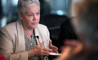 EPA administrator Gina McCarthy speaks with reporters at a breakfast in Washington in June. Photo by Getty Images