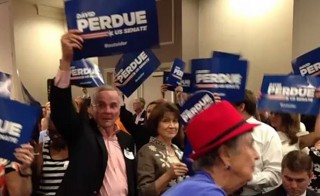 Supporters of David Perdue celebrate his victory over Jack Kingston Tuesday night in Atlanta. Photo by Claire Simms, GPB News