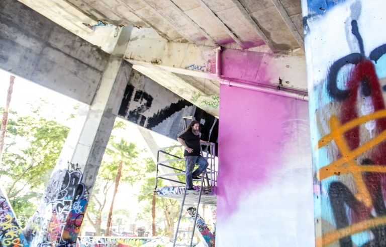 Graffiti artist RISK recently painted a color-field mural at Miami Marine Stadium, which sits abandoned.
