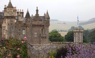 Sir Walter Scott's home, Abbotsford, in the Scottish Borders was built in the Scottish Baronial style.  It's where Scott wrote his world-famous Waverley novels. Image by Lorna Baldwin.