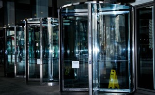 New research suggests the figurative revolving door between regulatory agencies and banks may not be as harmful as they're made out to be, and that shutting those doors would actually hurt the regulatory sector. Photo by Flickr user Valerie Everett.