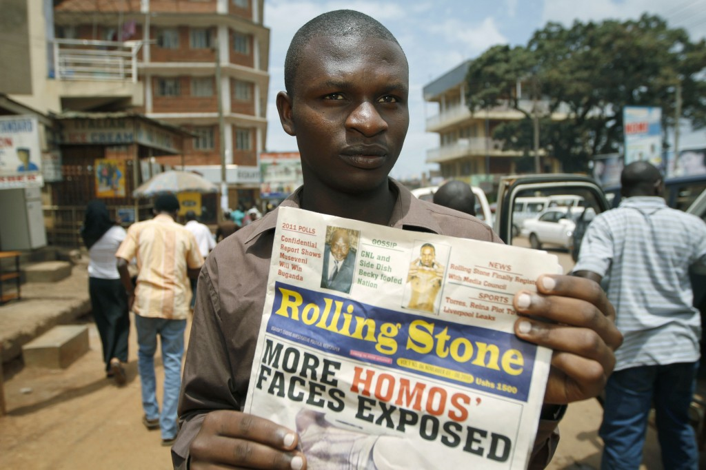 Editor of the Ugandan publication Rolling Stone holds a November 2010 issue of his newspaper, which published the names and photos of 14 men it identified as gay. Photo by Marc Hofer/AFP/Getty Images