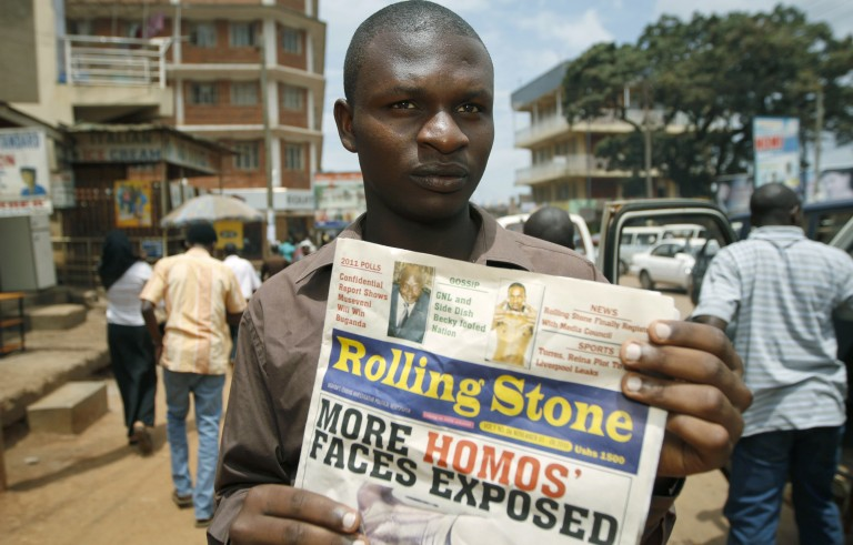 Editor of the Ugandan publication Rolling Stone holds a November, 2010 issue of his newspaper, which published the names and photos of 14 men it identified as gay.  Photo by Marc Hofer/AFP/Getty Images