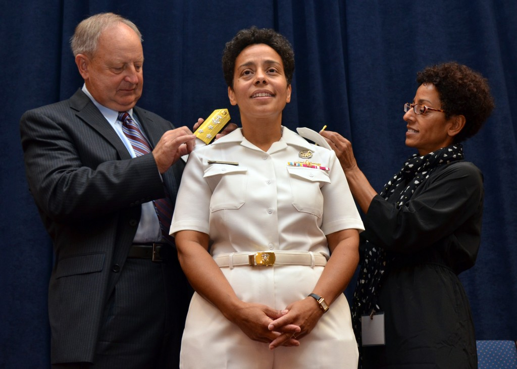 NORFOLK, Va. - Vice Adm. Michelle Janine Howard's husband, Mr. Wayne Cowles and her sister, Ms. Lisa Teitleman, replace shoulder boards during a promotion ceremony at Naval Support Activity Hampton Roads on Aug. 24, 2012. U.S. Navy photo by Mass Communication Specialist 1st Class (SW/AW) Rafael Martie