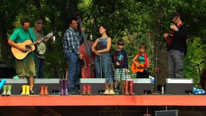 A group of Lyons, Colorado musicians displaced by the 2013 flood performed at the RockyGrass Music Festival. Photo by Josh Burleson