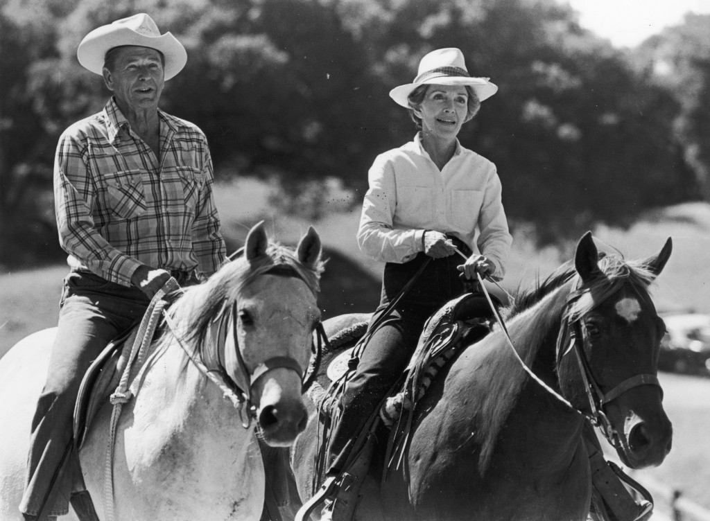 President Ronald Reagan and First Lady Nancy Reagan ride horses next to each other at their ranch in Santa Barbara, California.  Photo by Express/Express/Getty Images