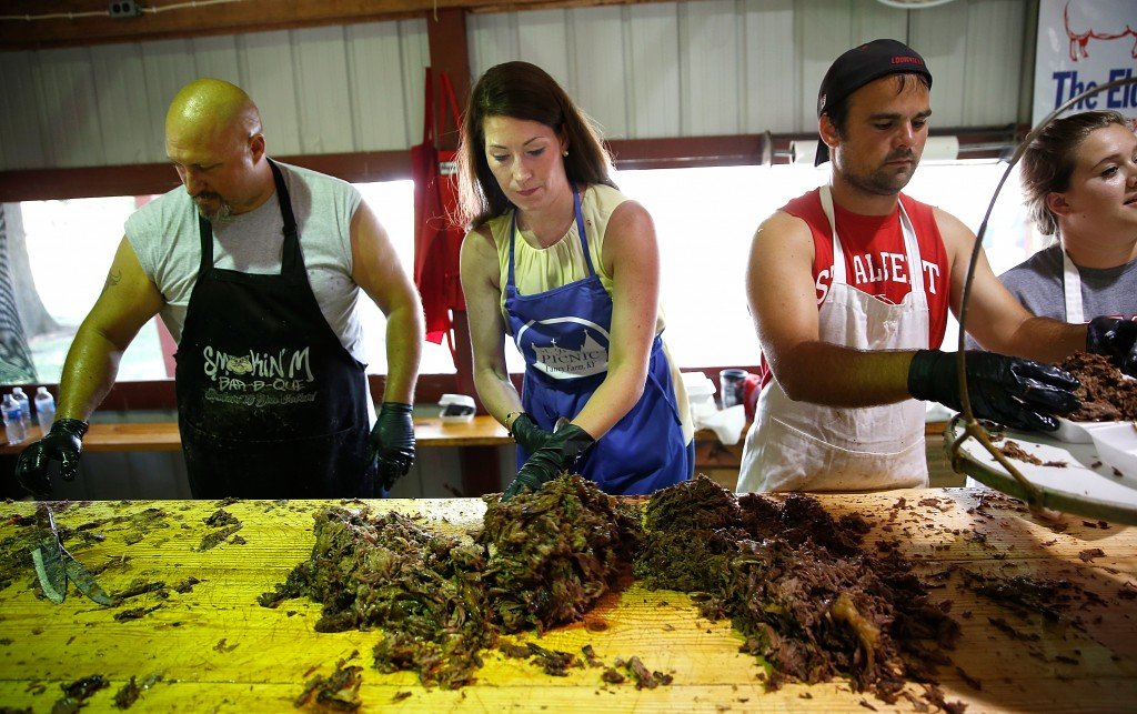 Kentucky's Democratic U.S. Senate nominee, and Kentucky Secretary of State, Alison Lundergan Grimes chops mutton barbeque at the Elder Family's barbeque stand at the Fancy Farm picnic August 2, 2014 in Mayfield, Kentucky. With today's annual Fancy Farm picnic, a Kentucky political tradition, recent polls show Grimes and Senate Minority Leader Mitch McConnell (R-KY) in a virtual tie. Photo by Win McNamee/Getty Images