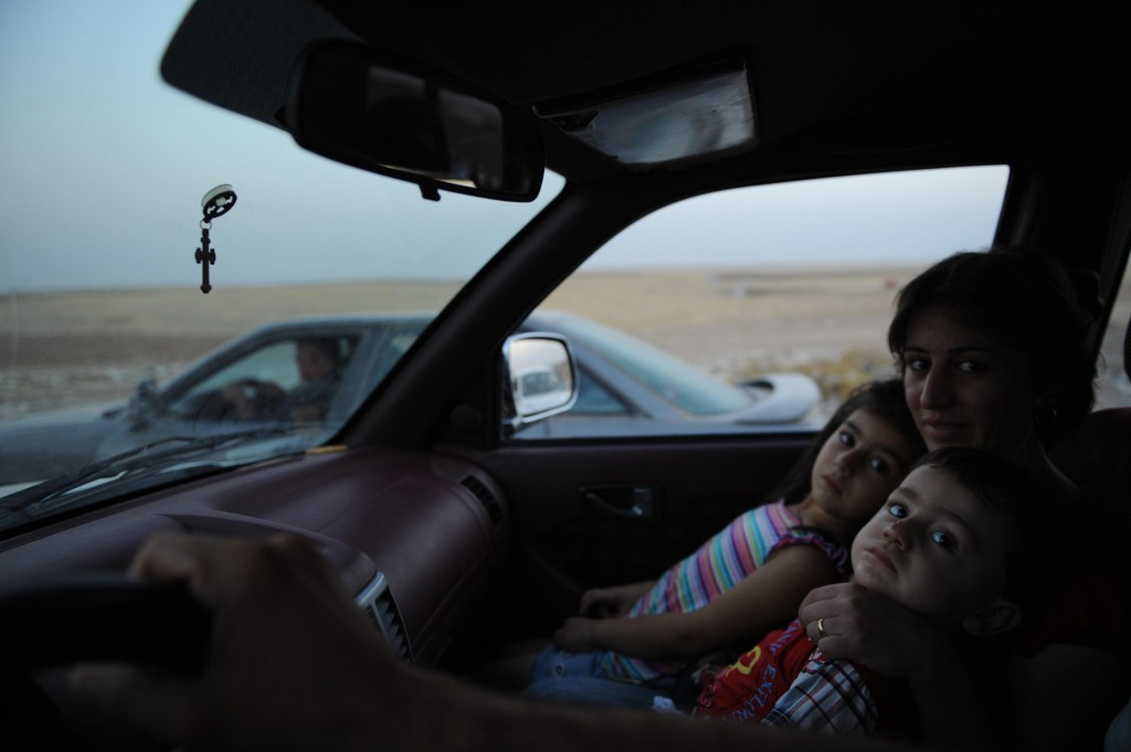 Thousands of Yazidi and Christian people flee Hamdaniyah town of Mosul to Erbil after the latest wave of Islamic State Group advances that began on Sunday has seen a number of towns near Iraq's second largest city Mosul fall to the militants on August 6, 2014. Photo by Mustafa Kerim/Getty Images