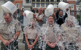 Lt. Sean Flood, Ranger Deb McNamara, Ranger Ted Fusco and Capt. Stephen Owens, who help provide security at the Massachusetts State House, participate in the ALS Ice Bucket Challenge on Aug. 7. Photo by David L. Ryan/The Boston Globe via Getty Images