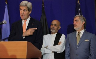 U.S. Secretary of State John Kerry, left, attends a press conference with Afghani presidential candidates Ashraf Ghani Ahmadzai, center, and Abdullah Abdullah, right, ahead o the second round of presidential election in Kabul, Afghanistan on Friday. Afghanistan's presidential candidates agreed to resolve their election dispute and will set the inauguration before the end of August. Photo by Haroon Sabawoon/Anadolu Agency/Getty Images