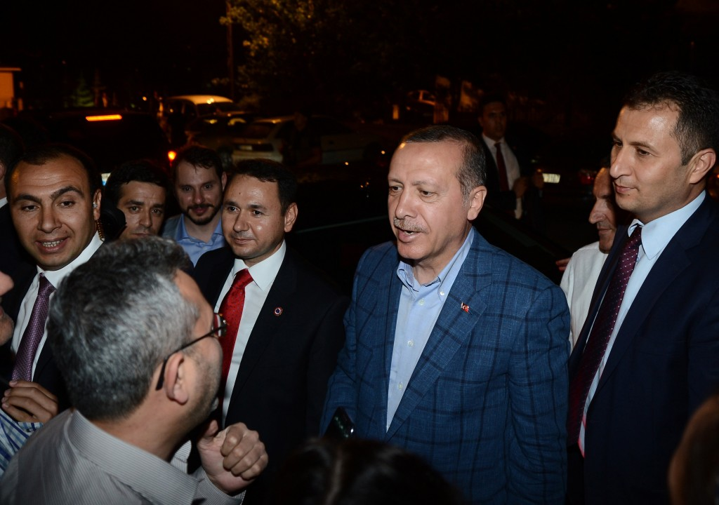 Recep Tayyip Erdogan (second from right), Turkey's president-elect, after his post-election speech at AK Party headquarters in Ankara on Aug. 11. Photo by Volkan Furuncu/Anadolu Agency/Getty Images