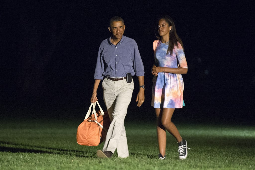 President Barack Obama and oldest daughter Malia return to the White House on August 17, 2014 in Washington, DC.Photo by Kevin Dietsch-Pool/Getty Images