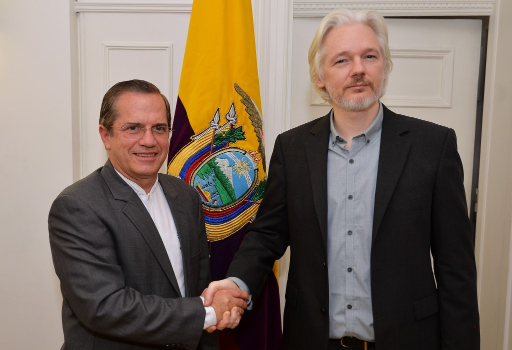 "Ecuador's foreign minister Ricardo Patino (left) shakes hands with WikiLeaks founder Julian Assange after a press conference inside the Ecuadorian Embassy in London, where Assange confirmed he ""will be leaving the embassy soon"". Photo by John Stillwell/PA Wire"