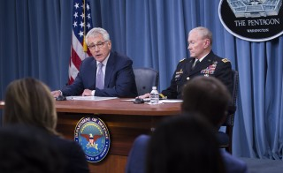 Secretary of Defense Chuck Hagel (left) and Chairman of the Joint Chiefs of Staff Gen. Martin Dempsey at a press briefing at the Pentagon in Washington, D.C., on Aug. 21. Photo by Saul Loeb/AFP/Getty Images