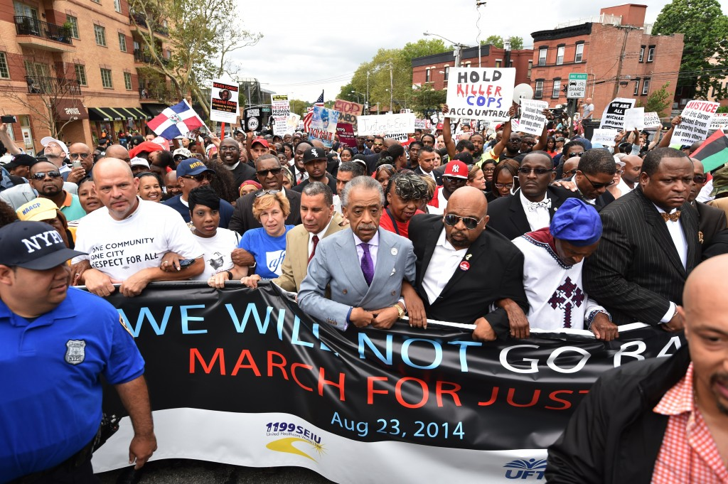 he Reverend Al Sharpton (C) marches with protesters at a rally against police brutality in memory of Eric Garner August 23, 2014 in Staten Island, New York. The New York City medical examiner's office ruled that Garner, the 43-year-old father of six, died from a chokehold and chest compressions while being arrested by the police on July 17, 2014. AFP PHOTO/Stan Honda (Photo credit should read STAN HONDA/AFP/Getty Images)