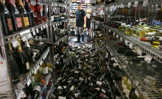 A worker looks at a pile of wine bottles that were thrown from the shelves at Van's Liquors following a reported 6.0 earthquake on August 24, 2014 in Napa, California. A 6.0 earthquake rocked the San Francisco Bay Area shortly after 3:00 am on Sunday morning causing damage to buildings and sending at least 70 people to a hospital with non-life threatening injuries. (Photo by Justin Sullivan/Getty Images)