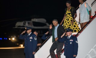President Obama, First Lady Michelle Obama and daughter Malia walk off Air Force One at Andrews Air Force Base in Maryland Sunday upon their return from their annual summer vacation at Martha's Vineyard. Photo by NICHOLAS KAMM/AFP/Getty Images