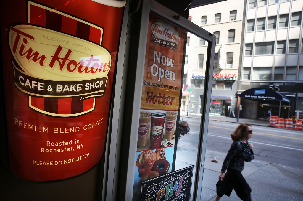 File photo of a Tim Hortons cafe in New York City taken on Aug. 25. The American fast food giant Burger King announced it has agreed to merge with Canadian coffee and cafe chain Tim Hortons. Photo by Spencer Platt/Getty Images
