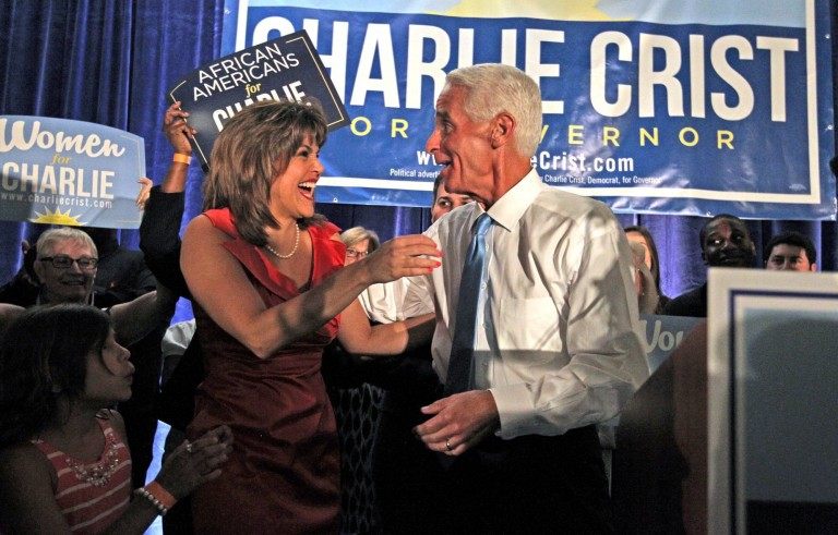 Charlie Crist hugs his running mate Annette Taddeo-Goldstein as they win the Democratic primary for the Florida governor's race Tuesday.  Photo by Charles Trainor Jr./Miami Herald/MCT via Getty Images