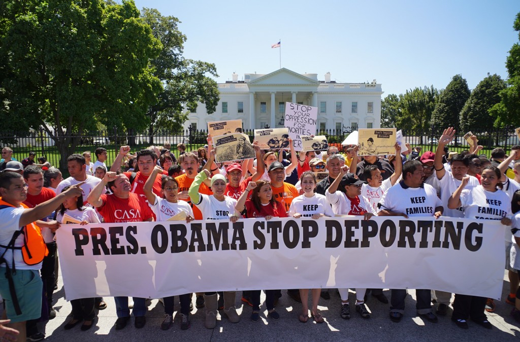 Immigrant rights activists shout slogans in front of the White House on August 28, 2014 in Washington, DC. Photo by Mandel Ngan/AFP/Getty Images