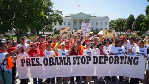 Immigrant rights activists shout slogans in front of the White House on August 28, 2014 in Washington, DC. The Associated Press reports that the Obama administration's been sharply cutting the number of deportations since at least 2007. Photo by Mandel Ngan/AFP/Getty Images
