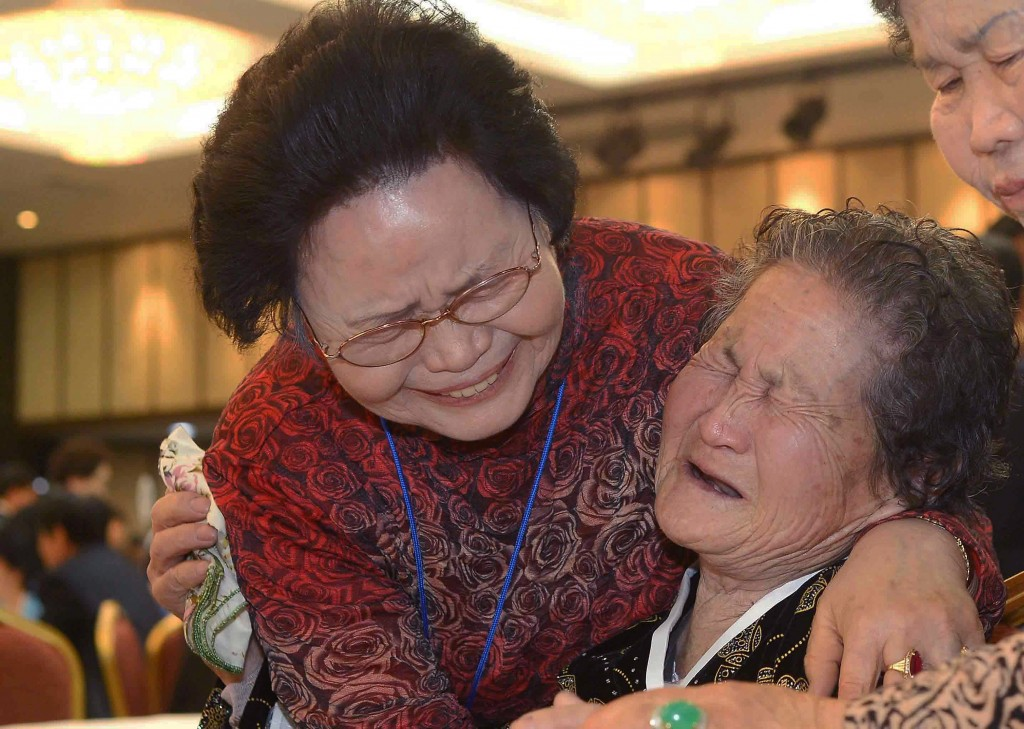 South Korean Kim Sa-Moon (left) meets with her North Korean older sister Kim Tae-Un, 78, during a family reunion after being separated for 60 years on Feb. 23 in Mount Kumgang, North Korea. Photo by Yoon Dong-Ju-Korea Pool/Getty Images