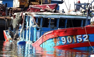 "This picture taken on June 2, 2014 shows the Vietnamese fishing boat ""DNA 90152"", which was reportedly sunk by a Chinese ship, at a shipyard in the central coastal city of Danang. Photo by STR/AFP/Getty Images"