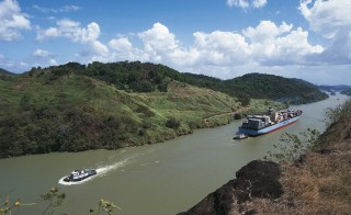 View from Contractor's Hill, Panama, of ships sailing in the Panama Canal in May 2014. A set of locks at either end eases ships through the artificial Gatun Lake, built to reduce the amount of excavation needed for the canal. A third set of locks, under construction and set to open in 2015, will allow wider ships to pass. Photo by DeAgostini/Getty Images