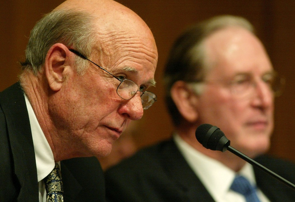 File photo of Sen. Pat Roberts, R-Kan., (left) with Sen. Jay Rockefeller, D-W.V., while Roberts was chairman of the Senate Select Intelligence Committee in Washington, D.C., on July 20, 2004. Photo by Alex Wong/Getty Images
