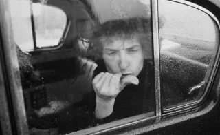 May 10, 1966 Bristol Colston Hall - Bob Dylan stares out the window of his limo during a rainy day in Bristol, England in early May 1966. Photo by Flickr user Paul Townsend