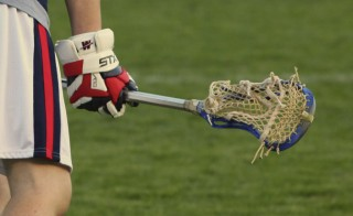"Some colleges are adding men and women's lacrosse teams to draw in ""full pay"" students. Photo credit: Gary Cooper"