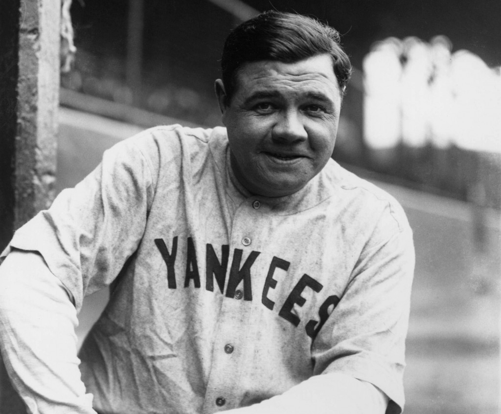 Babe Ruth poses in the visitors dugout in Cleveland in this 1927 photo. Photo by Louis Van Oeyen/Western Reserve Historical Society/Getty Images