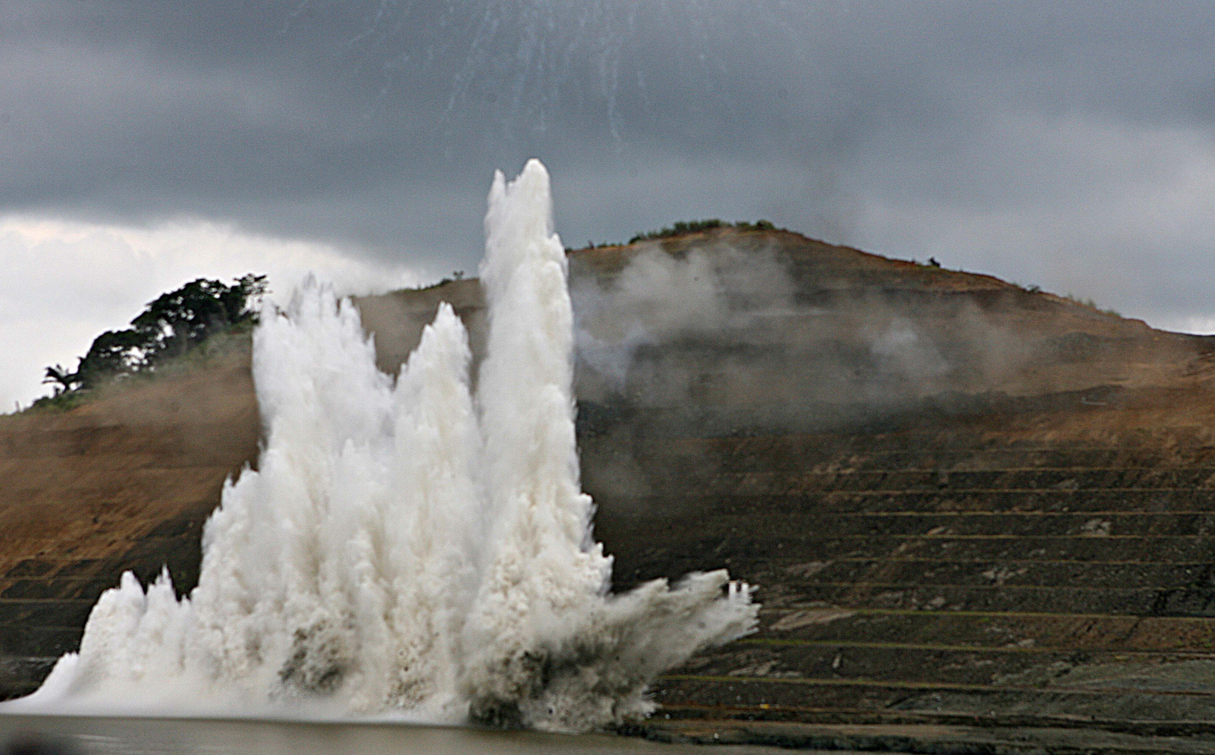 A controlled explosion sends water into the air in the Panama Canal during a Sept. 3, 2007 event celebrating the 30th anniversary of the 1977 treaty signed by then-President Jimmy Carter and Panamanian leader Omar Torrijos to transfer possession the canal to Panama at midnight Dec. 31, 1999. Photo by Susana Gonzalez/Bloomberg via Getty Images