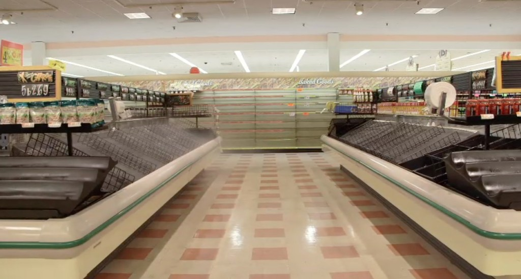 Entire aisles remain empty at this Market Basket store in Tewksbury, Mass. NewsHour still photo.