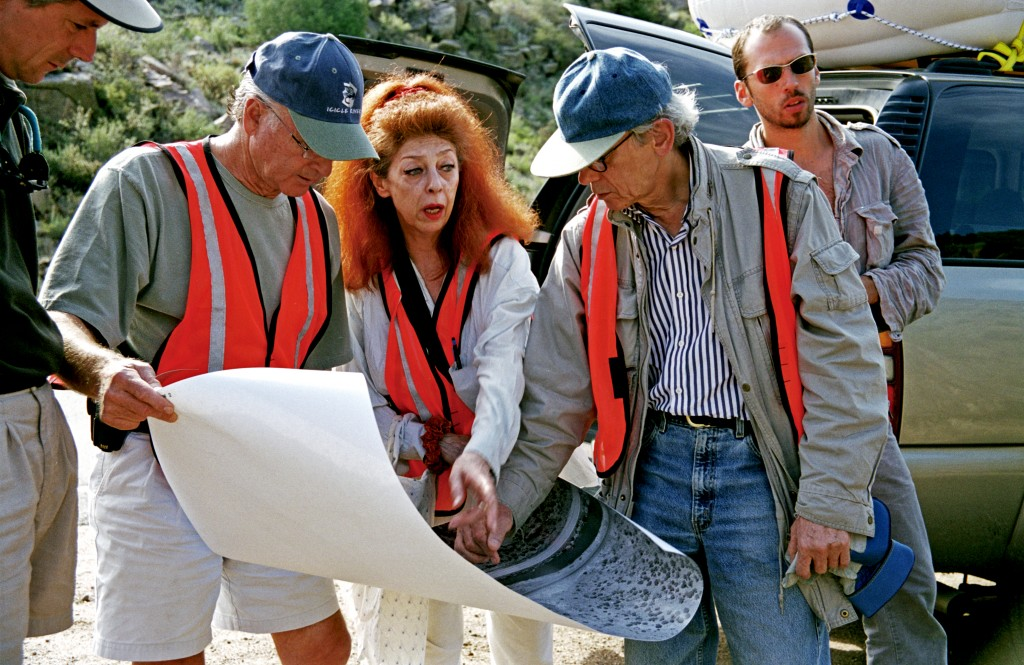 Christo, Jeanne-Claude and their team at work in the Arkansas River valley, Colorado, August 2000. Photo by Wolfgang Volz, © 2000 Christo