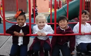 Before Yu Ming Charter School had a playground of its own, kindergarten students played in a public park during recess. Photo by Yu Ming Charter School