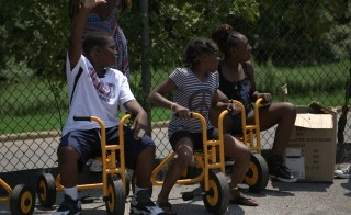 Children from the DCG Freedom School and Omega Freedom School enjoy a field day at Malcolm X Elementary School in Washington, D.C.  Photo by: Mike Fritz, PBS NewsHour