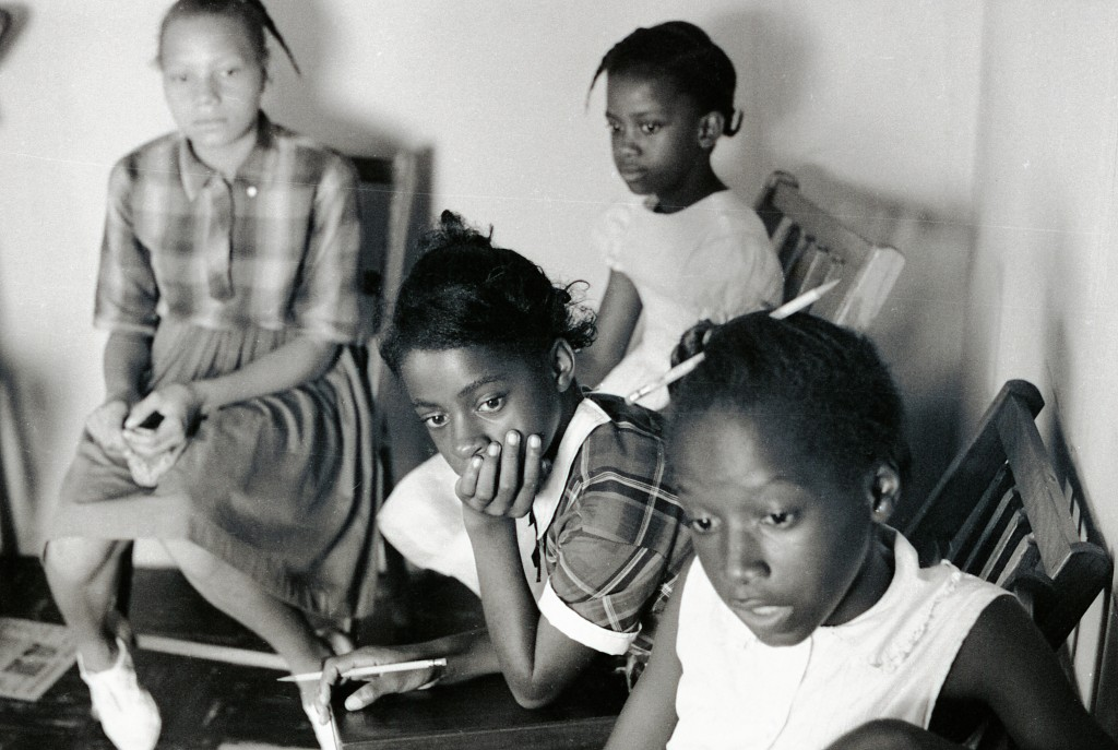 Four Freedom School students participating in class at Mt. Zion Baptist Church in Hattiesburg.  Photo by Herbert Randall from Herbert Randall Freedom Summer Photographs collection, McCain Library and Archives, the University of Southern Mississippi.