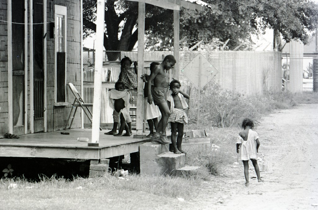 African-American children in Hattiesburg, Mississippi, standing outside of a house during Freedom Summer, 1964.  Photo by Herbert Randall from Herbert Randall Freedom Summer Photographs collection, McCain Library and Archives, the University of Southern Mississippi.