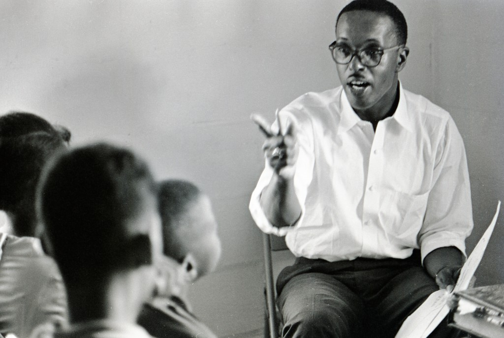 Volunteer Arthur Reese lecturing to a class of Freedom School students at Palmers Crossing in Hattiesburg, Mississippi, during Freedom Summer, 1964.  Photo by Herbert Randall from Herbert Randall Freedom Summer Photographs collection, McCain Library and Archives, the University of Southern Mississippi.