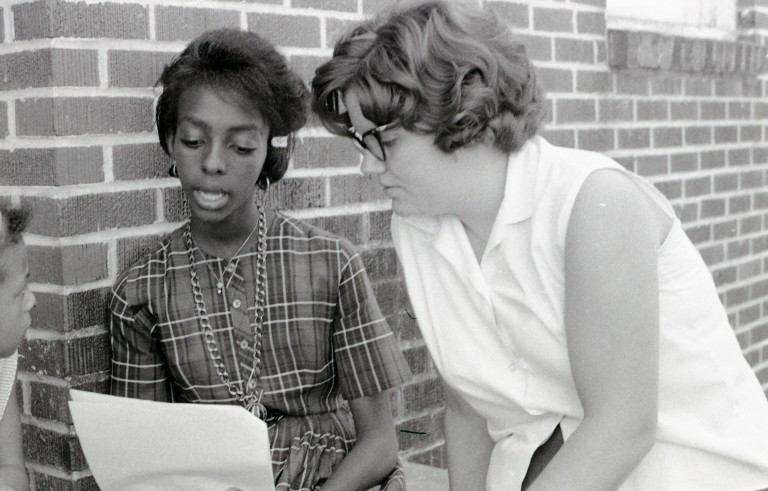 Freedom school student Cynthia Perteet (left) and volunteer Beth More (right) in Hattiesburg, Mississippi during Freedom Summer, 1964.  More was a teacher in the Freedom School hosted by Mt. Zion Baptist Church.  Photo by Herbert Randall from Herbert Randall Freedom Summer Photographs collection, McCain Library and Archives, The University Southern Mississippi.