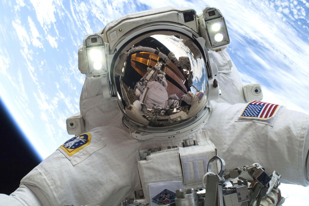 In space, no one can hear you snore. Astronaut Mike Hopkins takes a spacewalk outside the ISS in December, 2013. Photo by NASA