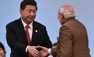 Chinese President Xi Jinping (left) shakes hands with Indian Prime Minister Narendra Modi during the sixth BRICS Summit in Fortaleza, Brazil, on July 15, 2014. Photo by Yasuyoshi Chiba/AFP/Getty Images